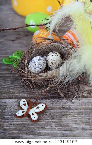 Easter Eggs In The Nest On A Wooden Background