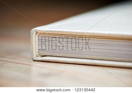 photobook with a cover of light leatherette