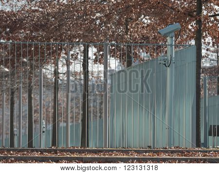Metal fence around private property with video cameras