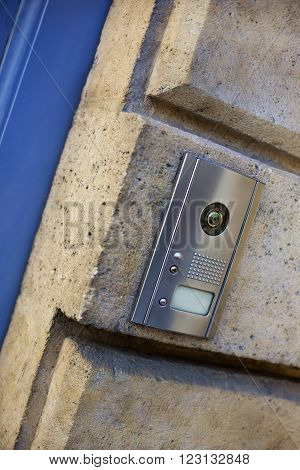 Modern intercom on the stone wall of an old French house