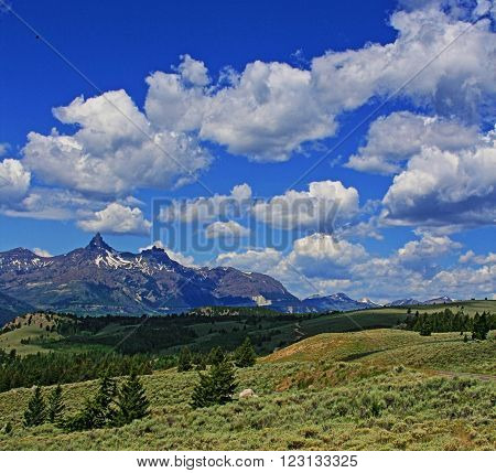 Bear Tooth Mountain under bright cumulus clouds in Wyoming USA