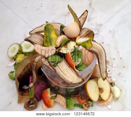 Fresh bio-waste in a bucket for composting on a marble plate