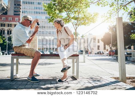 Senior Couple On Vacation Taking Pictures