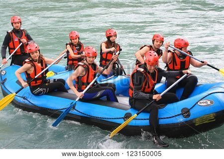 Foca, Bosnia, jun 2. 2015. Group of happy people with guide whitewater rafting and rowing on river