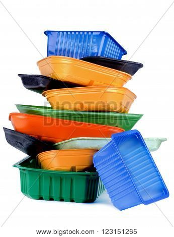 Arrangement of Various Colored Empty Recycled Trays isolated on White background