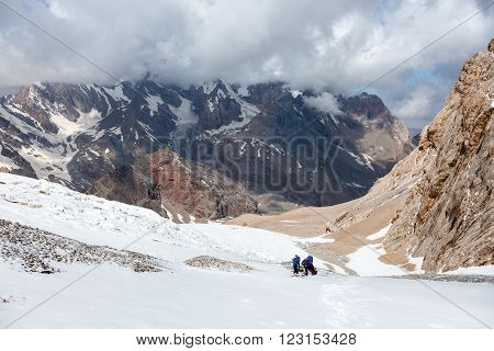 Mountain Valley Scenic View and Group of People on Snowfield Sporty Clothing with Climbing Gear Horizontal Composition