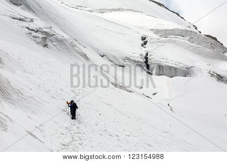 Climbers on Glacier Terrain Crossing Dangerous Crevasses poster