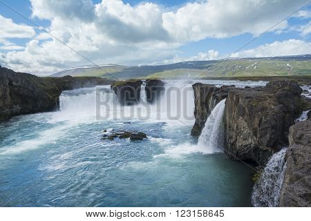 Gorgeous Godafoss waterfalls in north Iceland with a cloudy sky