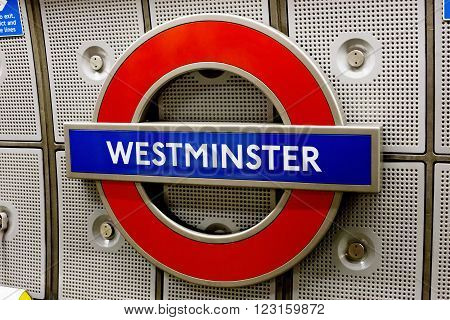 LONDON UK - DECEMBER 15 2014: Underground Westminster tube station in London . The London Underground is the oldest underground railway in the world covering 402 km of tracks.