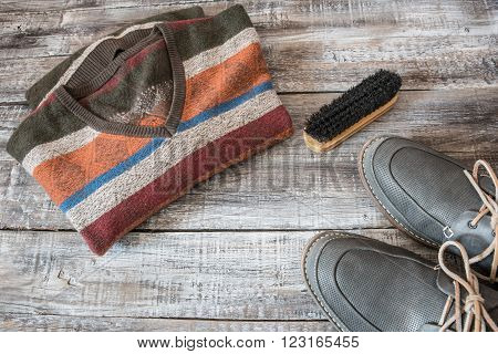 Travel vacation concept of random men objects on wooden background