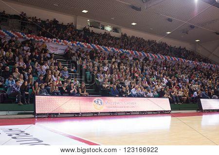 SAMARA RUSSIA - NOVEMBER 06, 2013: Fans and spectators on the stand during the BC Krasnye Krylia and BC Royal Hali Gaziantep basketball game on November 06 2013 in Samara Russia.