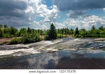 wild nature of Canada, river, forest, blue sky and white clouds