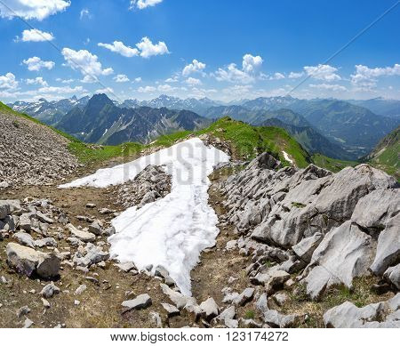 Last snow in the summer Allgau Alps with mountain Hoefats above Oberstdorf, Germany.