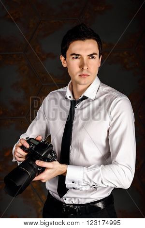 Professional photographer ready for shot in studio in white shirt and black tie ** Note: Soft Focus at 100%, best at smaller sizes