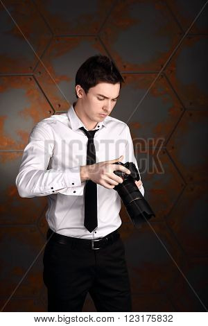Professional wedding photographer is flipping photos on his photocamera