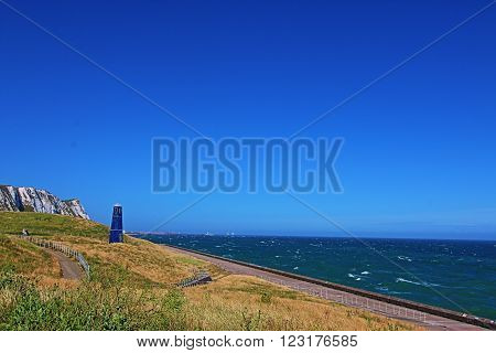 Samphire Hoe Tower along the Dover Seawall at the White Cliffs of Dover in Great Britain GBR