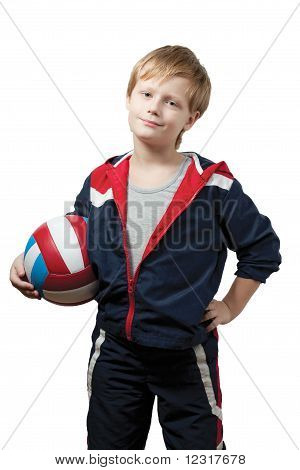 The cute little boy in a jumpsuit holds a ball