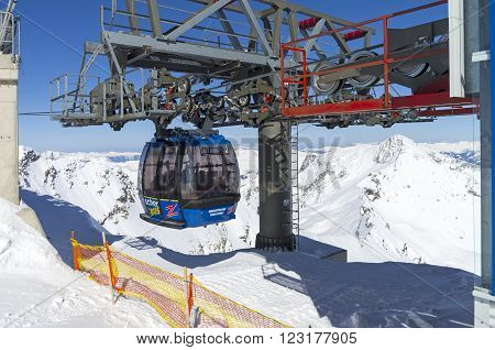 HINTERTUX GLACIER, AUSTRIA - MARCH 17, 2016: Cableway in the Austrian Alps. Mact and gondola. The top of the Hintertux Glacier 3250 meters above sea level.