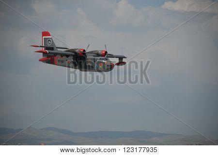 ANKARA TURKIYE MAY 6, 2012 : Canadair CL-215 firefighting aircraft over the Etimesgut airport before the water dump mission. May 6, 2012-Ankara/Turkey