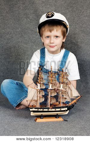 Child with the model ship.
