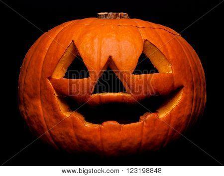A scary Halloween pumpkin on black background