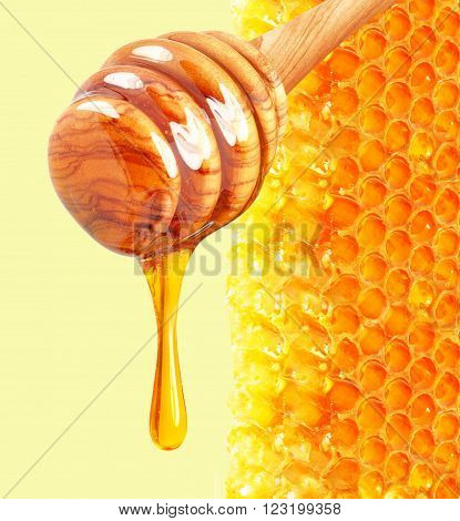 dripping honey and honeycomb isolated on background