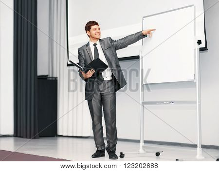 the speaker at a business presentation in the conference room