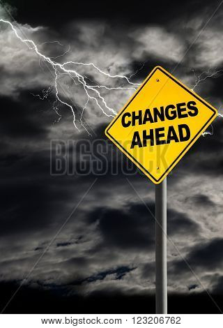 Changes Ahead sign against a dark cloudy and thunderous sky. Conceptually warning of danger ahead. Copy space and vertical orientation.