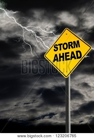 Storm Ahead warning sign against a dark cloudy and thunderous sky. Concept of political storm personal crisis or imminent danger ahead. Vertical orientation