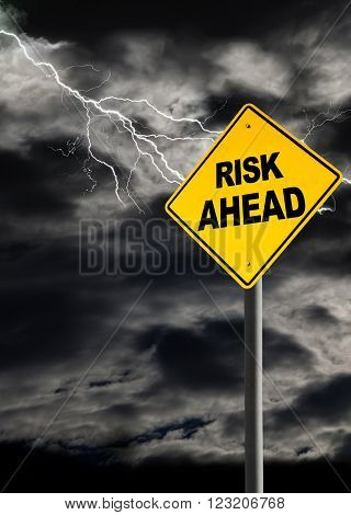 Risk Ahead warning sign against a dark cloudy and thunderous sky. Concept of political storm personal crisis or imminent danger ahead. Vertical orientation