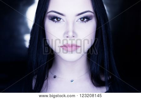 conceptual portrait of a brunette girl with long straight hair