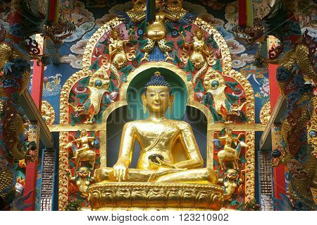 BYLAKUPPE, KARNATKA/INDIA - MAR 13: Golden statue of Gautama Budha at Golden temple Bylakuppe, Mar 13, 2016 in Bylakuppe, Karnataka, India.