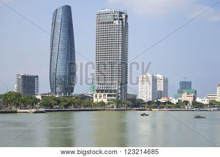 DA NANG, VIETNAM - JANUARY 06, 2016: The Han river and two high-rise buildings. Skyline of Da Nang. The landmark of Da Nang