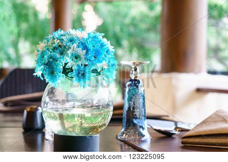 Restaurant table setting with tableware and flower