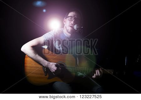 Man Singer In Plays Guitar And Sings.