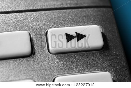 Close Up Of A Grey Fast Forward Button On Chrome Remote Control For A Hifi Stereo Audio System