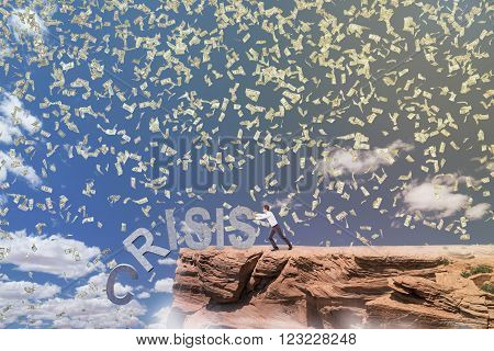 Businessman pushing letters of word 'crisis' from rock. Blue sky and dollars fall at background. Concept of coping with crisis.