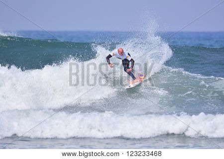 TAPIA DE CASARIEGO, SPAIN - MARCH 24:  Unidentified surfer participating in  Classic Goanna pro XXV memorial Peter Gulley (World Qualifying Series) in March 24, 2016 in Tapia de Casariego, Spain.