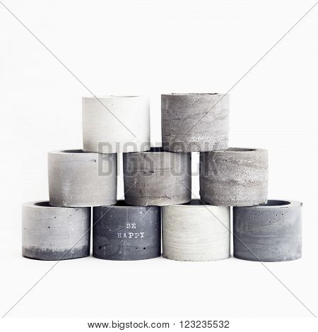 Handmade concrete planters for succulents in grey shades. Scandinavian minimalistic design for home.