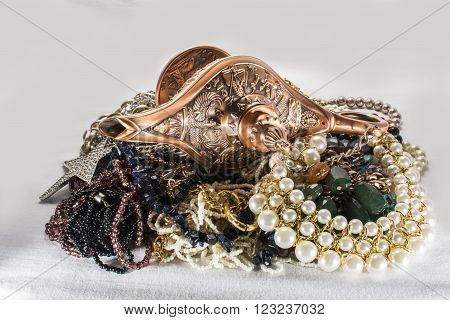 Aladdin's lamp isolated on different jewels background