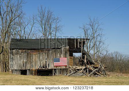 American Flag on Old Falling Down Barn