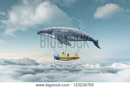 Take me to the dream, travel concept. Whale floats in the air above the clouds carrying children in a yellow airplane.