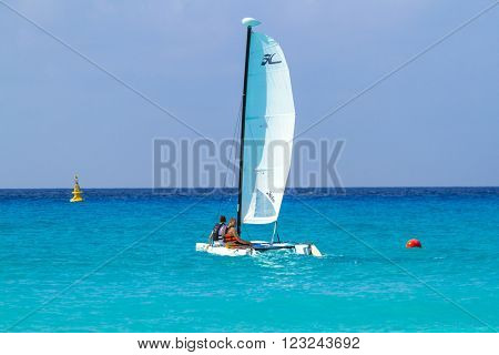 PLAYA DEL CARMEN, MEXICO - JULY 13, 2011: Unidentified people on the catamaran at Caribbean Sea of Mexico. Playa del Carmen area is very popular tourist destination with the most beautiful beaches.