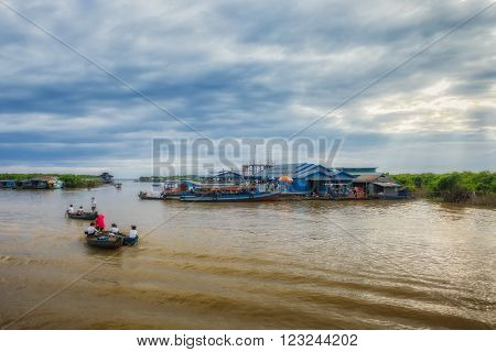 SIEM REAP, CAMBODIA DEC. 16: Cambodian people live on Tonle Sap Lake in Siem Reap, Cambodia on December 16, 2011. The floating village on the water (komprongpok) of Tonle Sap lake.