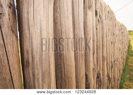 High Old Wooden Fence Of Logs In Form Of Palisade
