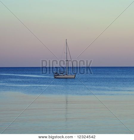 Sailboat Reflected On Sea Water