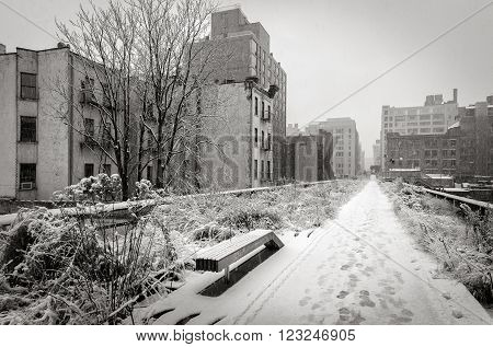 Black & White view of the High Line covered in snow after winter snowstorm. Chelsea, Manhattan, New York City