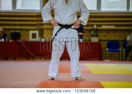 Chelyabinsk, Russia -  March 19, 2016: judoka fighter before fight on tatami in white kimono and black belt in Russian competition on judo