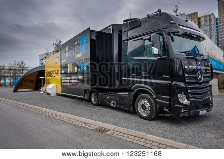 HANNOVER GERMANY - MARCH 15 2016: SAP Go Beyond CRM demo truck stands near SAP company booth at CeBIT information technology trade show in Hannover Germany on March 15 2016.