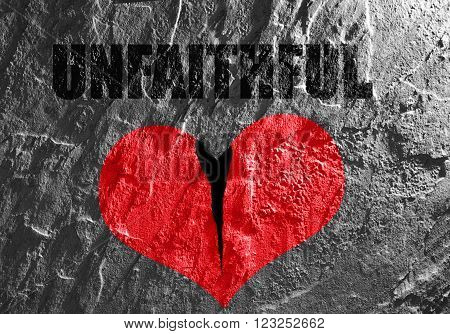 Red heart on textured background with Unfaithful text